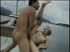 Wild young bimbo lifts up her leg to have her twat slammed on a boat