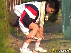 Kinky asian pees street