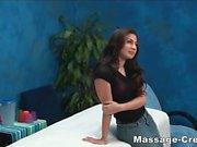Teen brunette giving a blowjob during massage