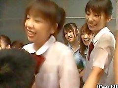 Asian schoolgirls swarm a hardened dick