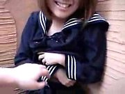 Shy Japanese teen with a pretty smile is ready to be sexual