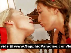 Gorgeous redhead and blonde lesbians licking and fingering pussy and having lesbian sex