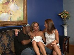 Cougar and young babe share one hard black hunk on the sofa