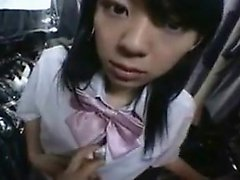 Pretty Asian schoolgirl spreads her legs and reveals her ti