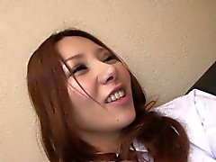 Asian redhead bitch rubbing on her wet pussy
