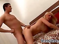 Granny Seduces A Young Guy