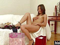 Skinny girl plays with a big dildo