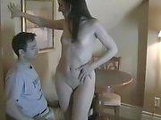 Petite brunette teen in kinky latex outfit teasing her boyfriend