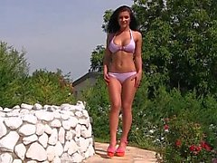 Well shaped Euro babes posing by the pool