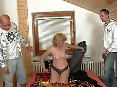 Naughty grandma pays the delivery boys with sex