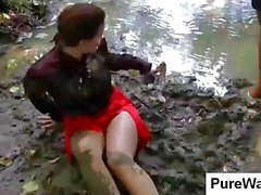 Out taking a stroll in nature two young hottie chicks get dirty in a muddy stream