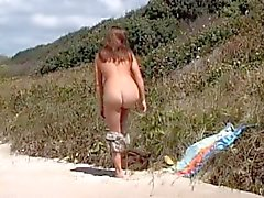 Young girl masturbating on the beach
