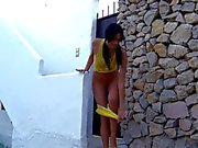 Slender Mia gets filmed while having fun in back yard