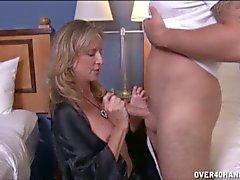 Blonde milf gives throbbing cock horny handjob