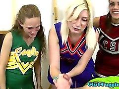 Blonde teen cheerleader jerks and tugs cock