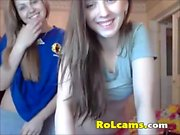 Lesbian teens stripping and licking tits on webcam
