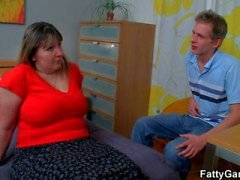 Mature bbw sucks an young hard cock.