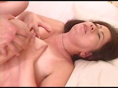 Asian MILF Chizuru Iwasaki gets a young boy to eat cock and fuck