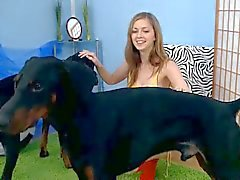 Cute teen spunky bee plays with her dogs