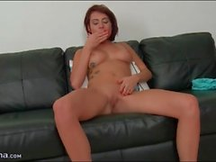Cutie fingers her pierced pussy passionately