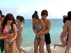 Group sex on the beach leads to creampie Asian pussies