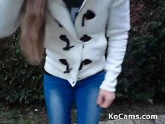 Teen brunette blowjob in garden