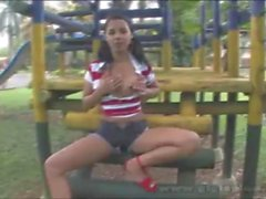 Gigi Spice toying at the playground
