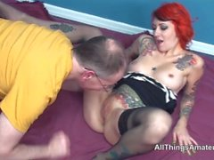 Tattooed redhead Scarlet Storm older fuck with facial