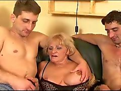 Horny grandma is at it again with two huge boners on couch