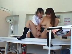 Busty schoolgirl sits on the table and gets her pussy exami