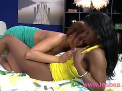 Lesbea Black British woman rubs her wet pussy on teen girl