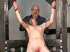 Slave gets restraint bound to table master gives nipple torture with clamps