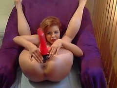 Natural redhead toying her teen pussy