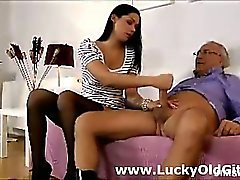 Young babe gives blowjob to older British guy