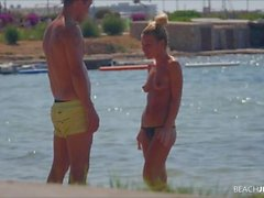 Topless girlfriend on the beach