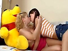 Naughty teen lesbian girls play with a big black dildo