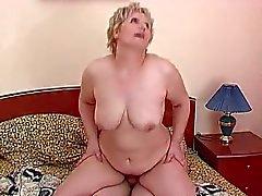 Mature and chubby enjoys a young cock