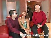 Eden De Garden is one hot and nasty wife that loves to sleep around but she does that with her husband's consent. If you were Eden De Garden's husband, would you let her strip in front of the camera and watch while she does two guys at once?