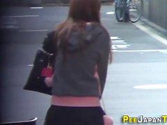 Asian teen babe peeing