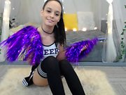 Wild brunette cheerleader drives a dildo in and out of her