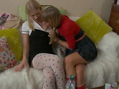 Horny blonde teens fuck with toys on the sofa