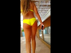 amazing yellow bikini ass in beach club