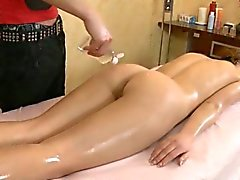 Guy is massaging awesome babe with oil
