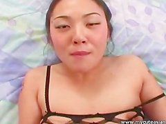 Nasty Asian slut smoking while sucking dick and in fishnet lingerie!