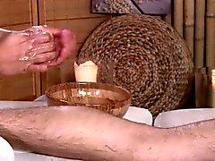Massage babe jerking client cock