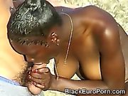 Gorgeous African teen blows 2 big European rods at the beach