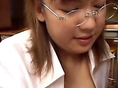 Office babe Eri with glasses gives a nice handjob and blowjo