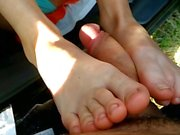 Footjob in the car and outdoors with cum on soles