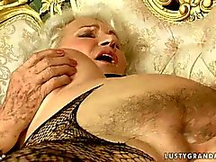 Granny and young beauty have hot sex