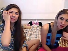 Two frisky young bimbos are eager to get undressed for the